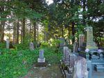 Buddhist cemetery in woods in Haguro