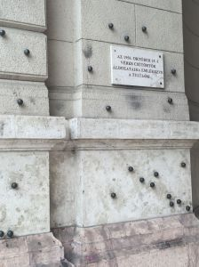 Near Parliament, bullet holes from the 1956 uprising with black markers